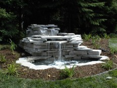 Stone Waterfall Feature In Yard